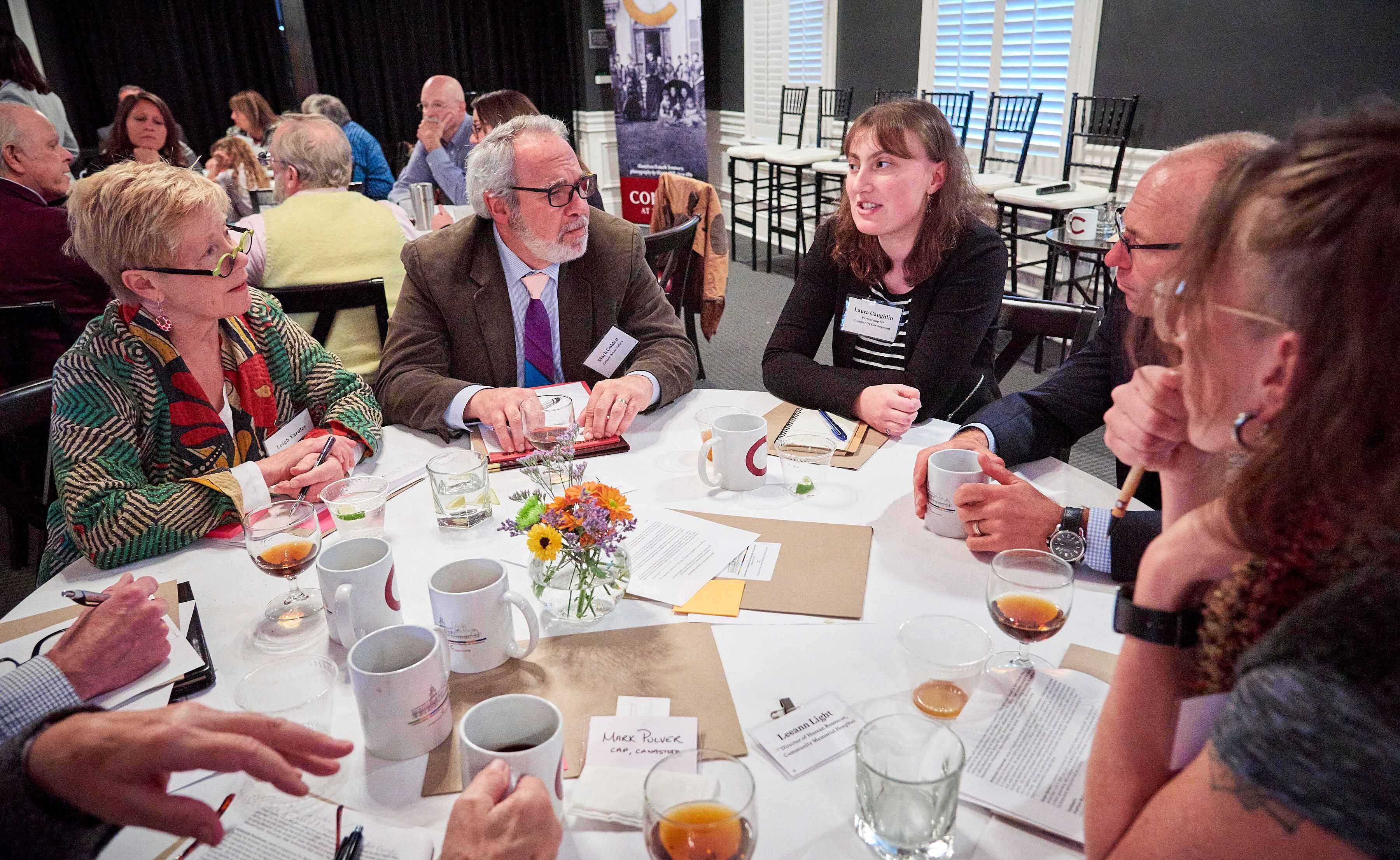 Participants at the 4C conference discuss economic development ideas on Oct. 25.