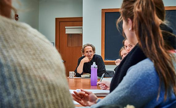 Students in class with Colgate professor Peter Balakian