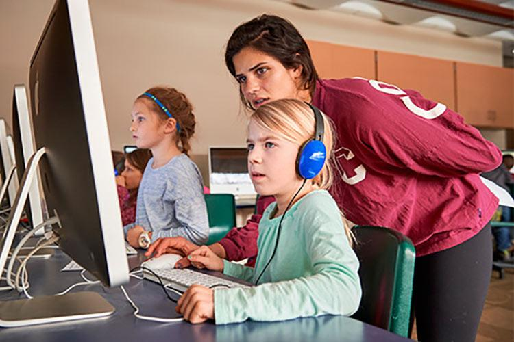 Colgate Women in Computer Science students help teach coding to local elementary school students.
