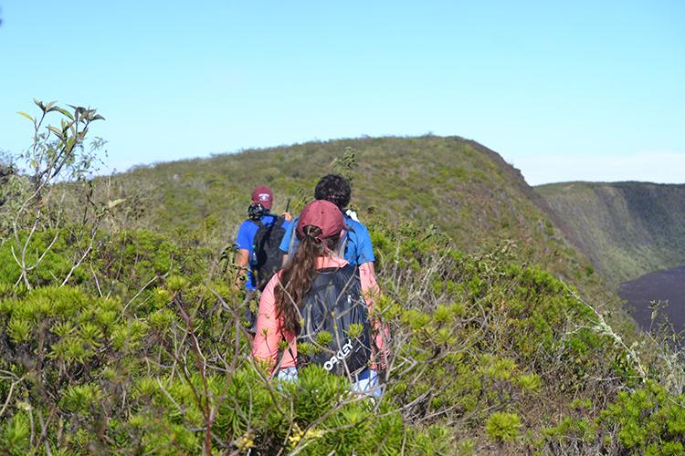 Students hike Sierra Negra, a volcano, to capture footage in the Galapagos Islands.
