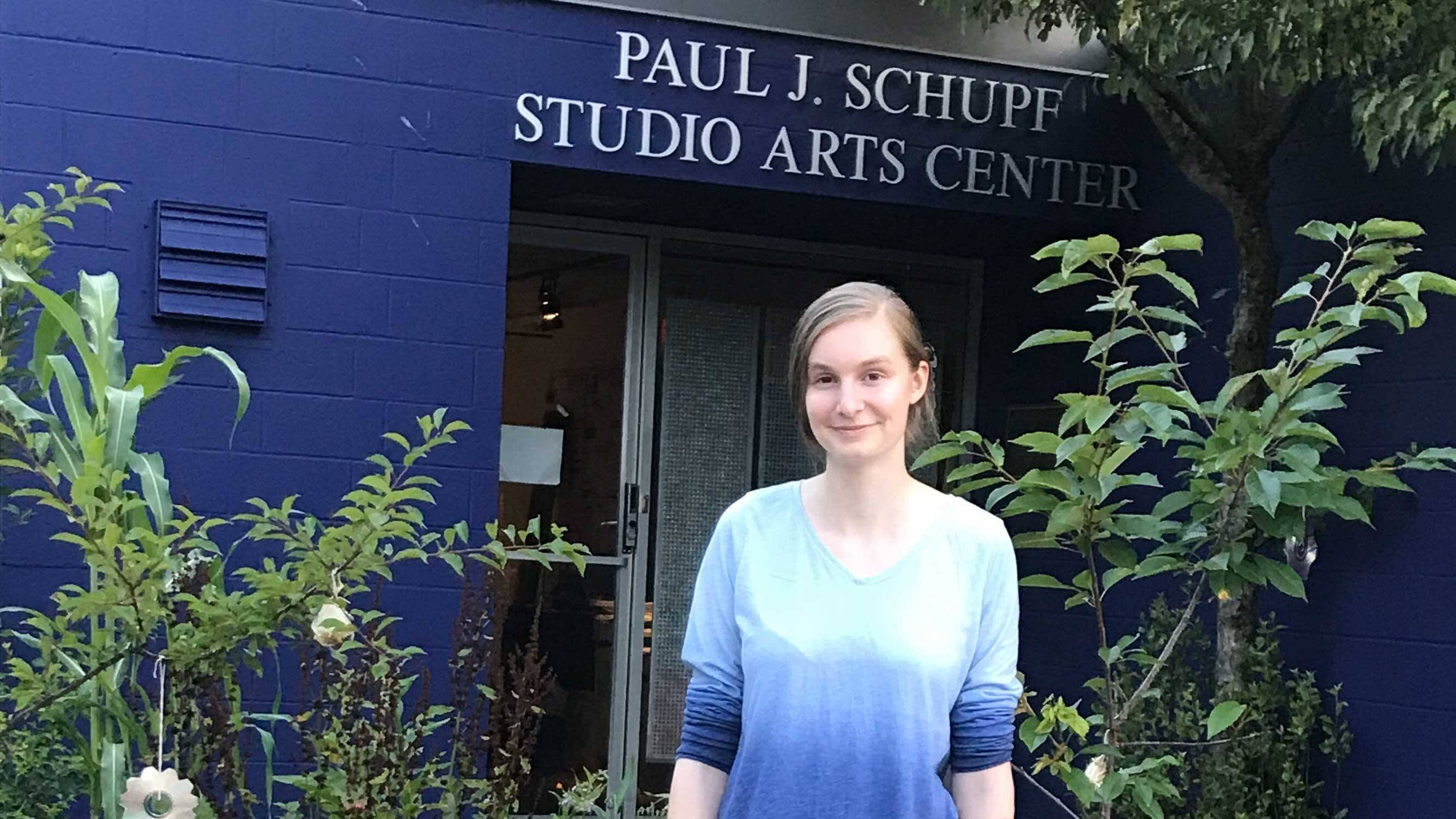 Keara Greene '20 in front of Schupf Studio Arts Center