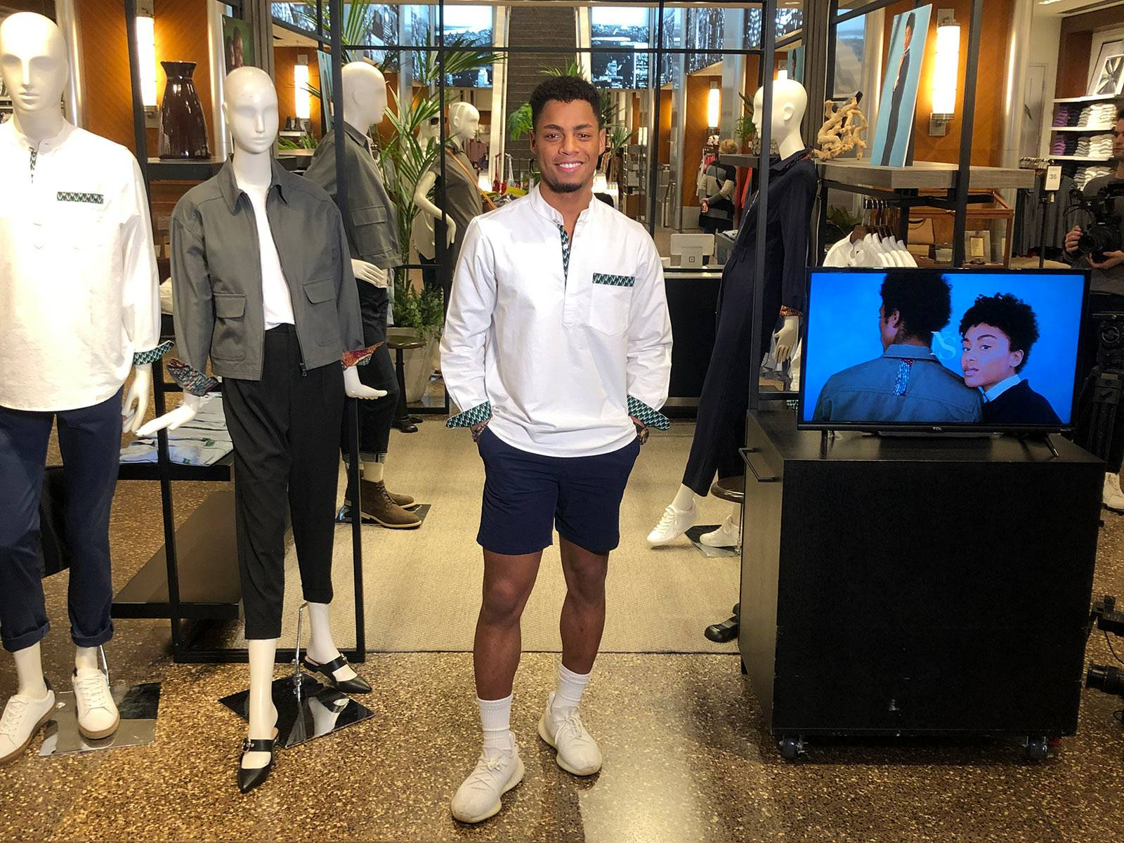Uyi Omorogbe stands in Banana Republic store