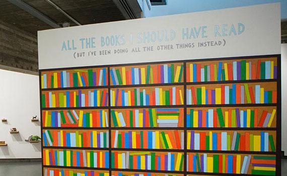 "Work from Picker Gallery exhibition depicting painted bookshelf with title ""All the books I should have read (but I've been doing all the other things instead)"