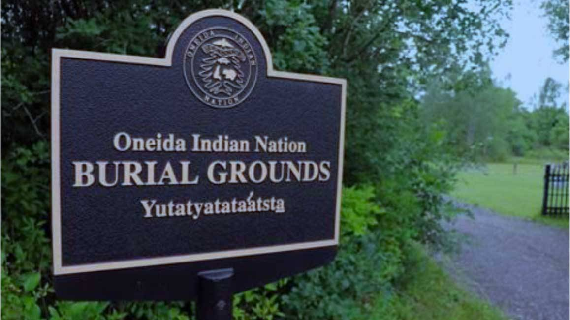 A sign outside of the Oneida Indian Nation burial grounds