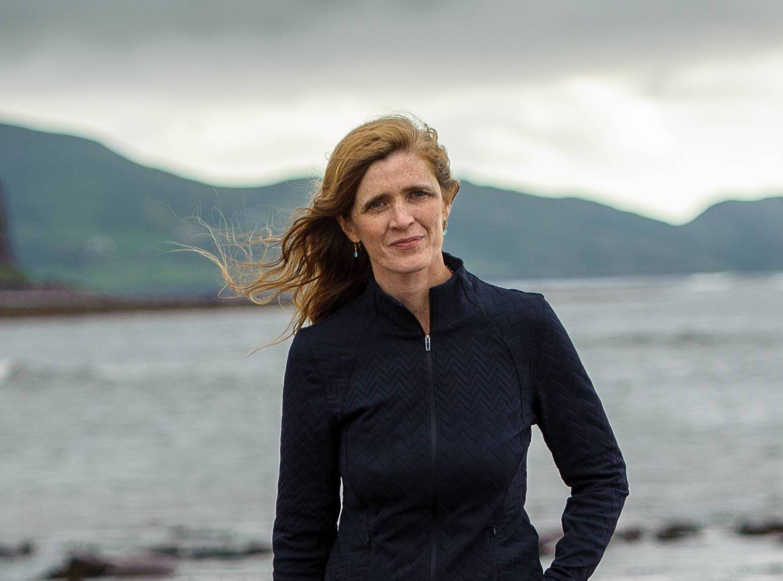 Ambassador Samantha Power, water and mountains in backdrop