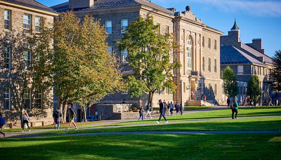 Students walk along the Colgate Academic Quad during the fall.