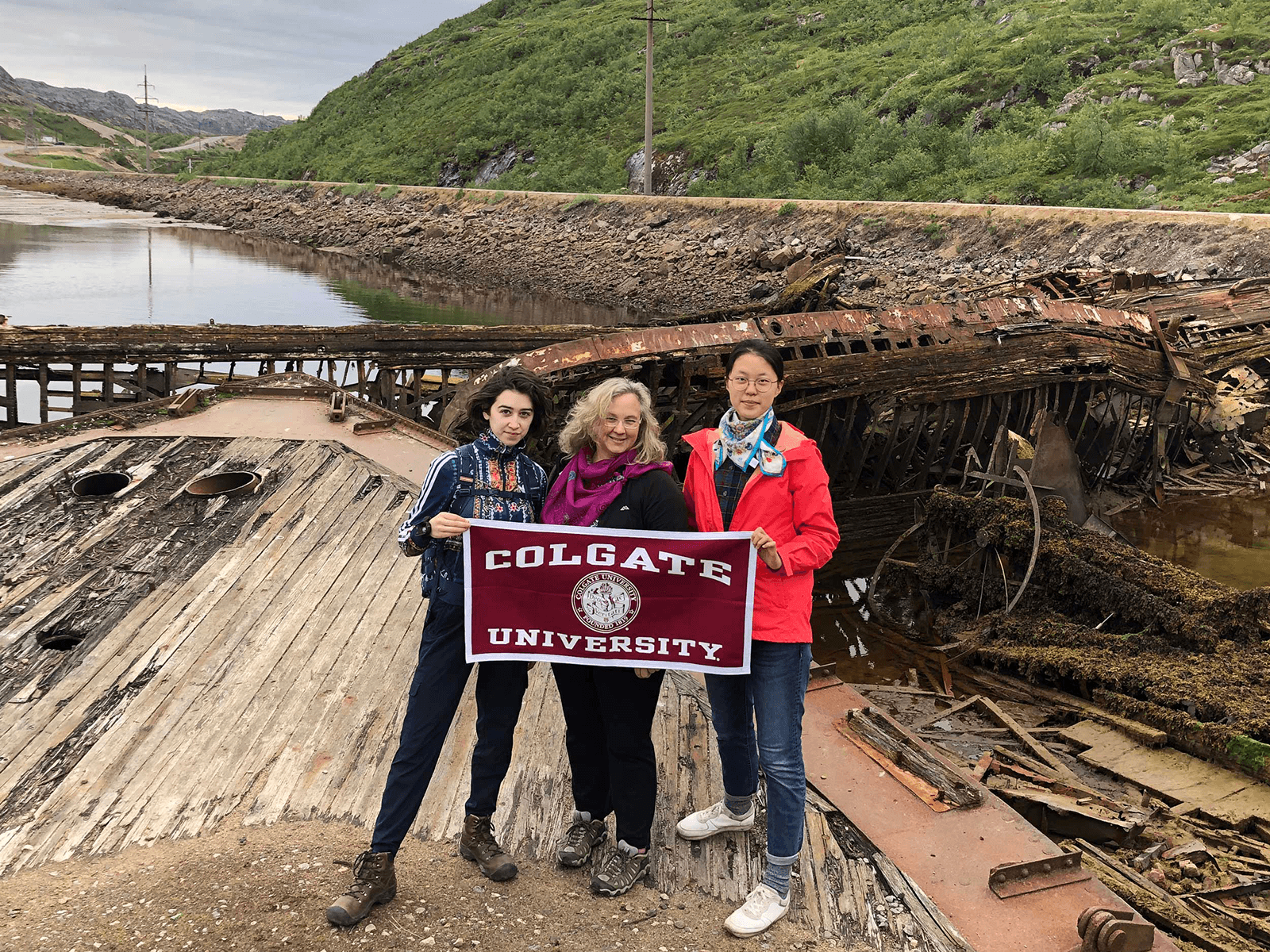 Student interns Yang Zhang and Isobel Hooker pose with Professor Graybill at their Russian research site, Teriberka.