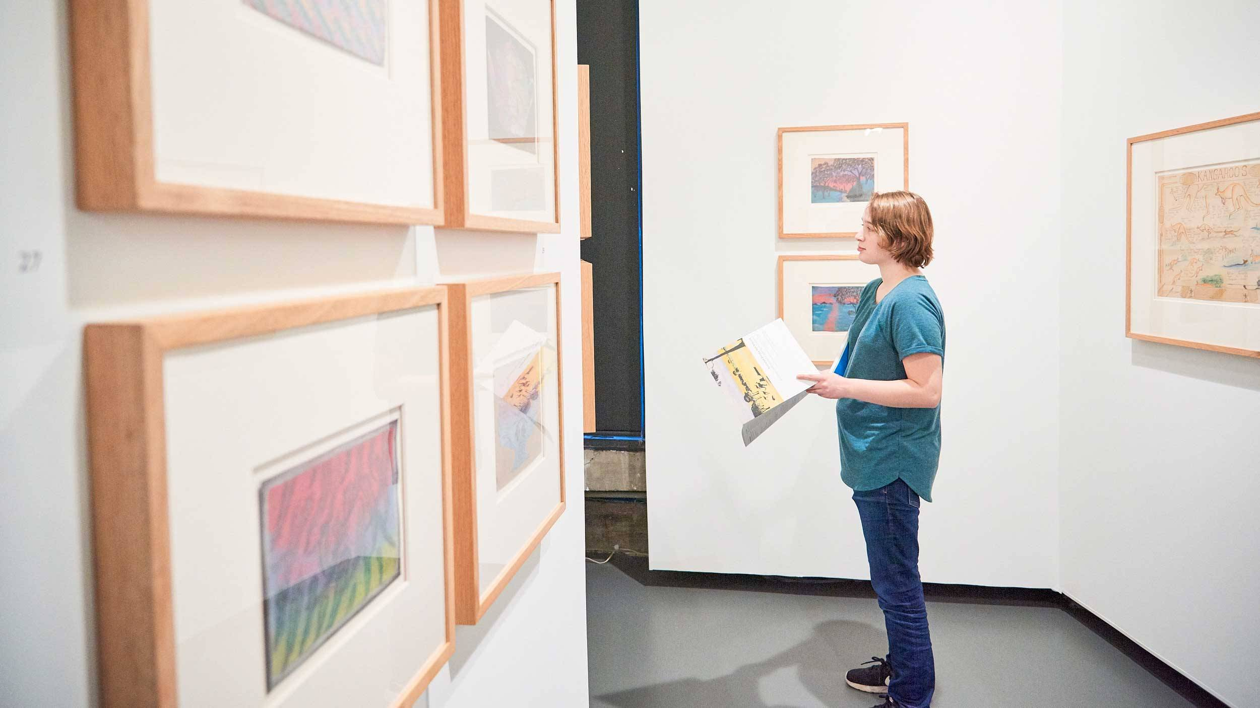 Student views artworks in the Picker Art Gallery