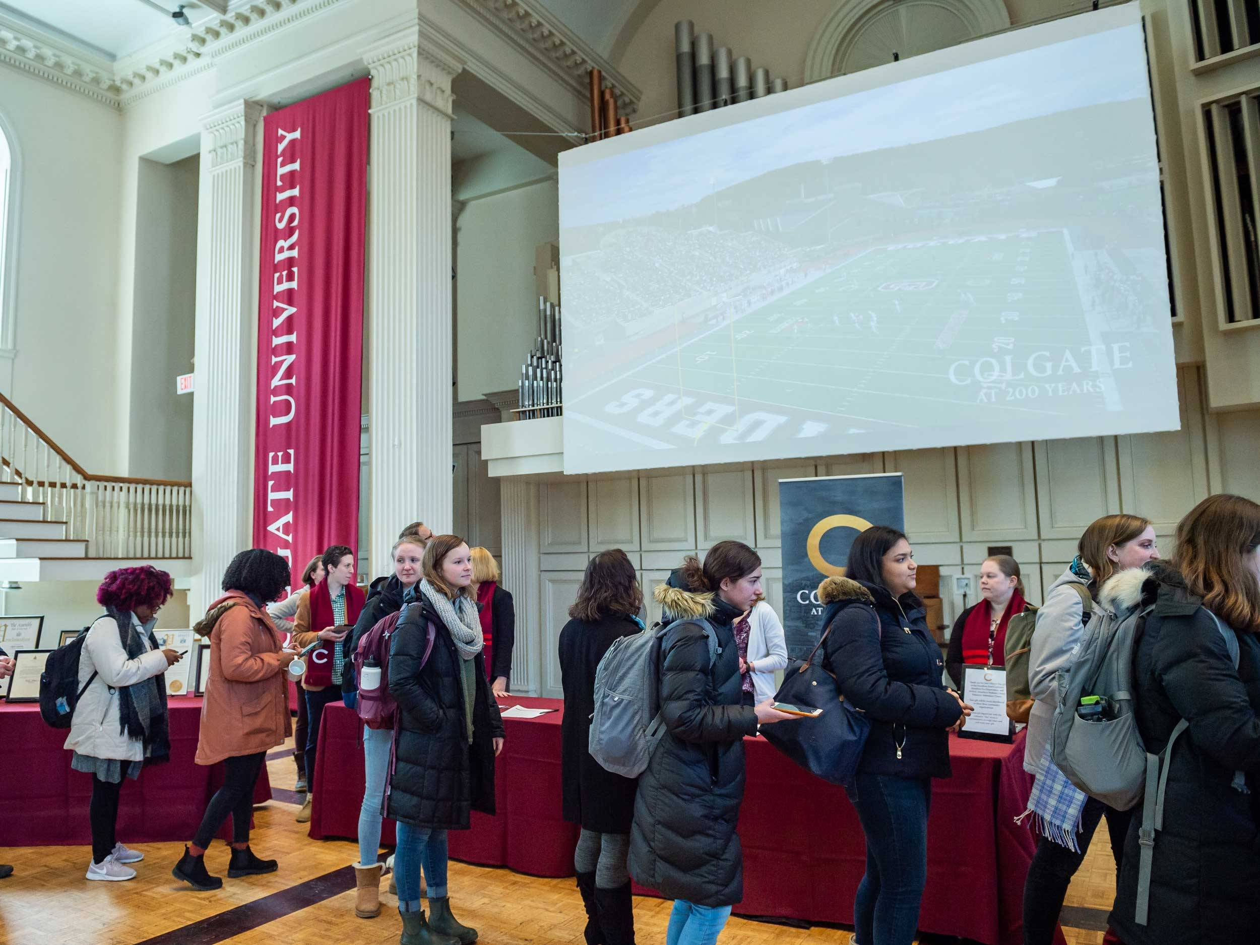 Colgate community members line up to celebrate Charter Day in Memorial Chapel