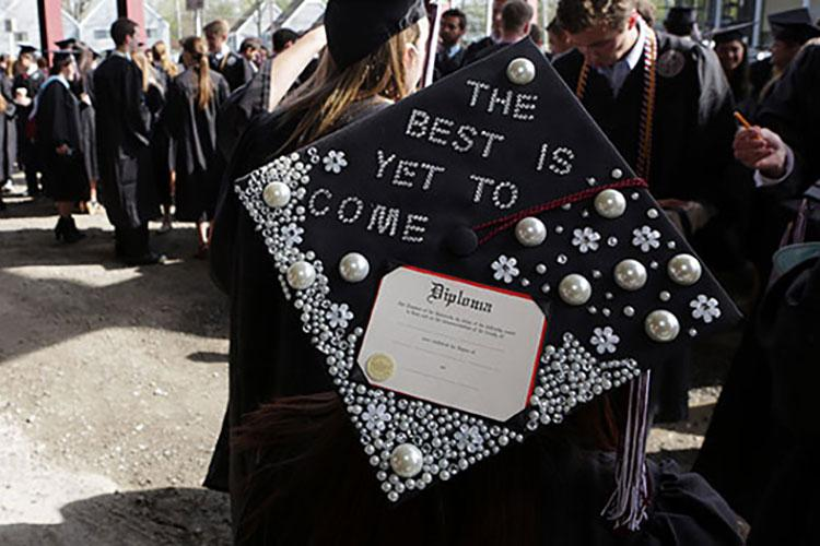 "Glitter-adorned graduation cap that reads ""The best is yet to come"""