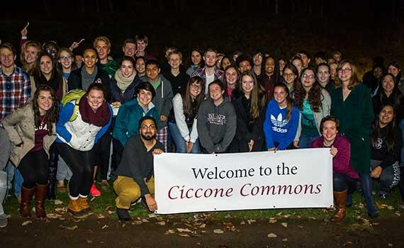 "Students hold up a sign reading ""Welcome to the Ciccone Commons"""