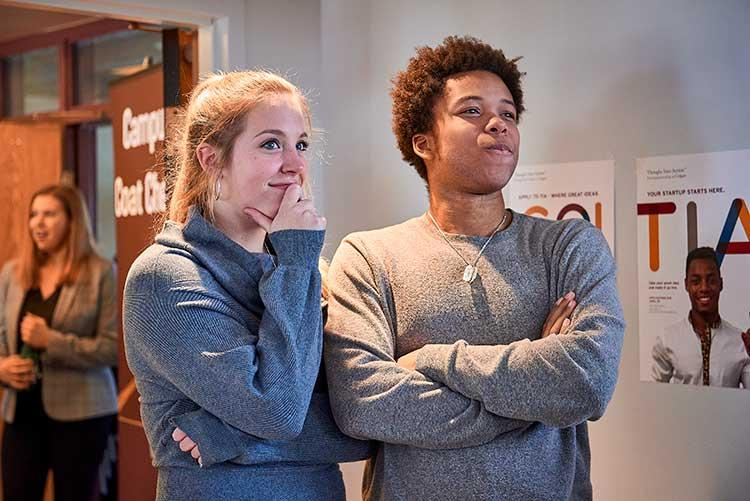 Brandon Doby '18 and Lauren Sanderson '18 stand together during Entrepreneur Weekend event