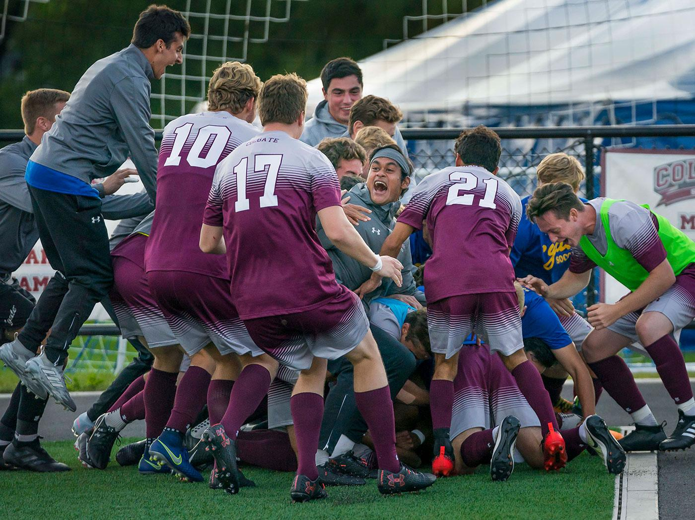 Soccer team piles up to celebrate