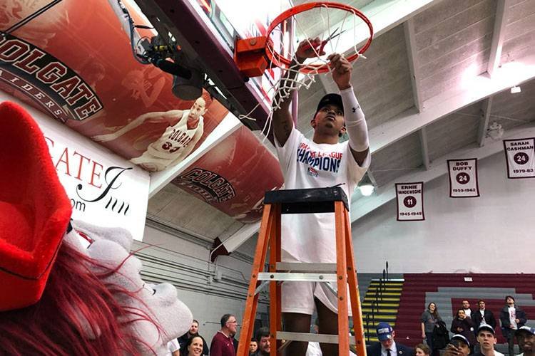 Colgate Raider makes a basket as Colgate Men's Basketball Wins First Patriot League Championship in 23 Years.