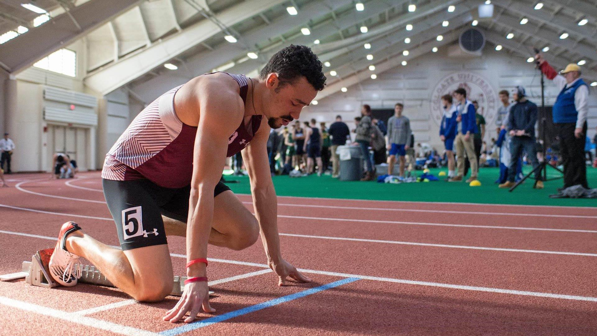 Oliver Moe at the starting block for a race in Colgate's Sanford Field House
