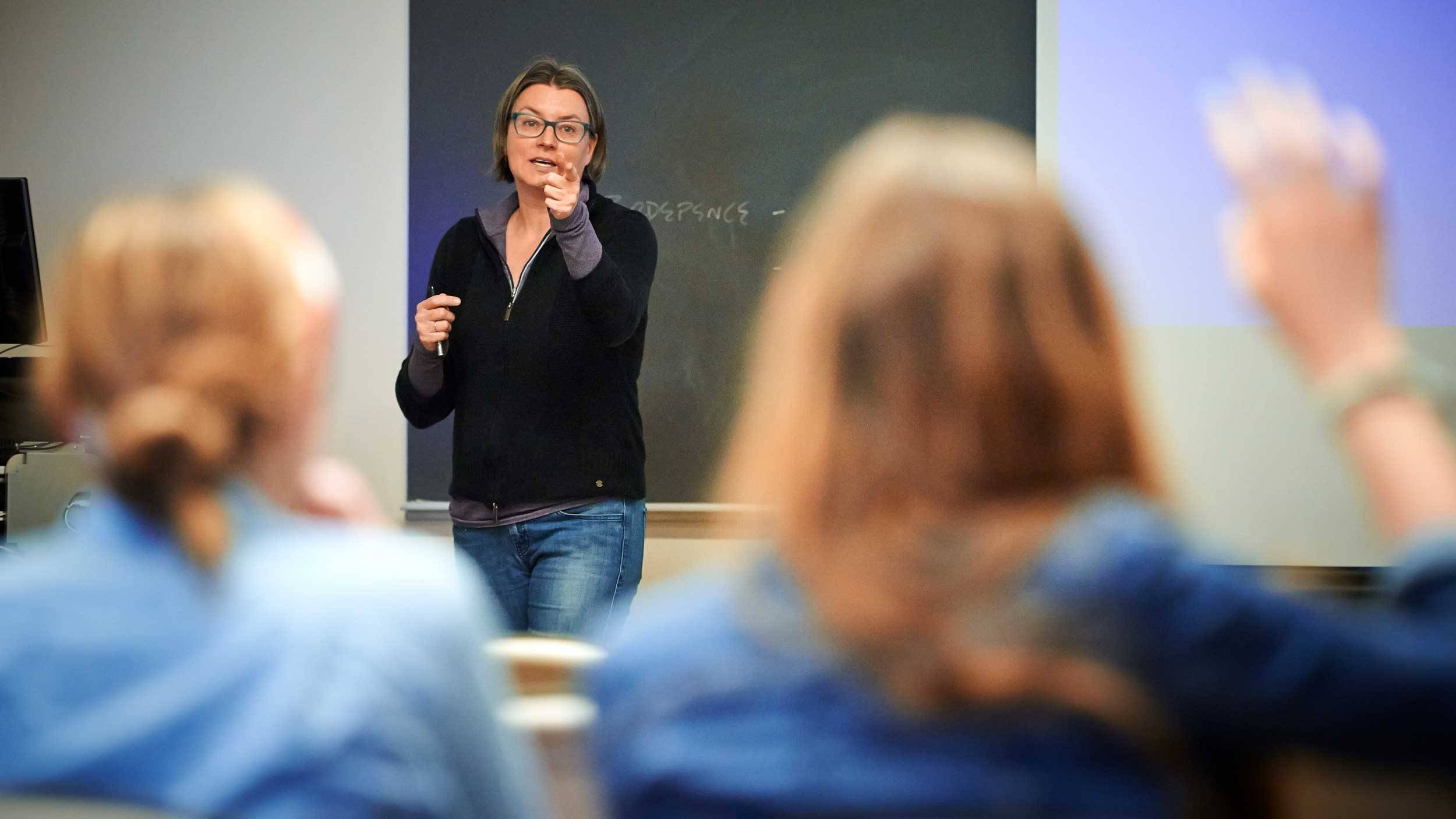Prof. Susan Thomson speaks to students in a classroom