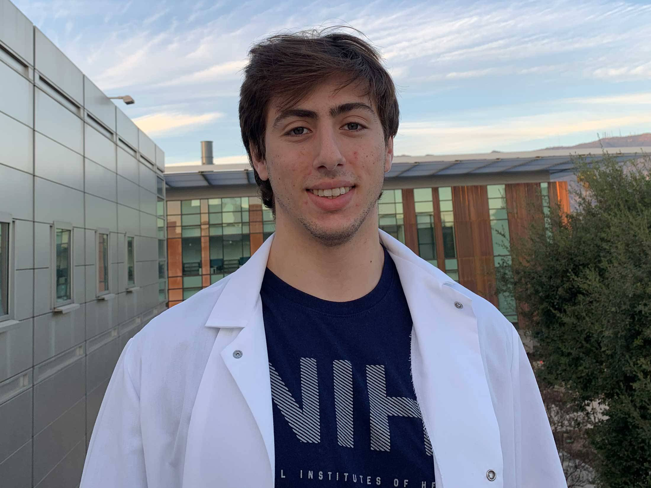 Portrait of William Rosencrans '19 in lab coat